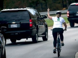 Juli Briskman gives the PotUS the one finger salute